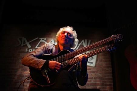 John Doan peforms at the Six Bar Jail with the harp guitar.