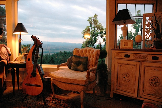 John Doan - living room concert - the chair awaits in his home.