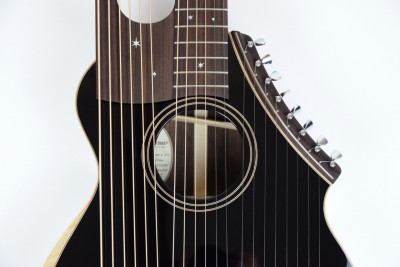 Brunner Travel Harp Guitar close up on face