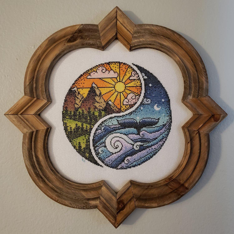 A cross-stitch yin yang by Emma Congden