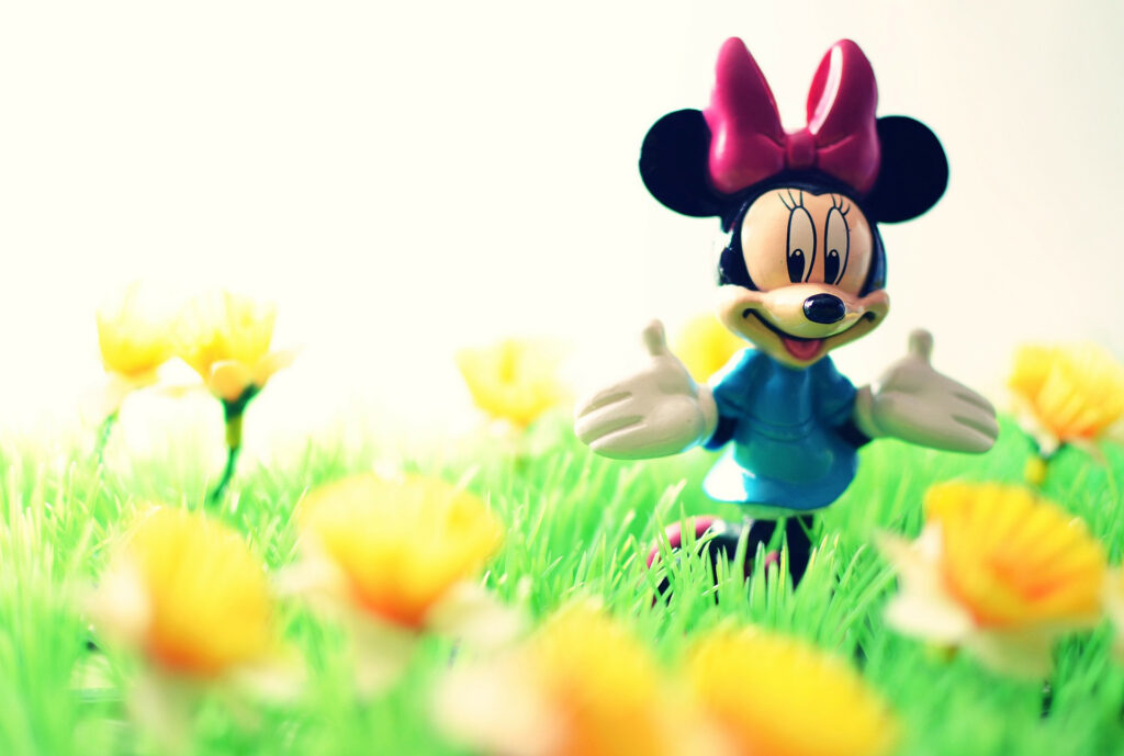 Minnie Mouse stands in a field of yellow buttercups. =gtg=