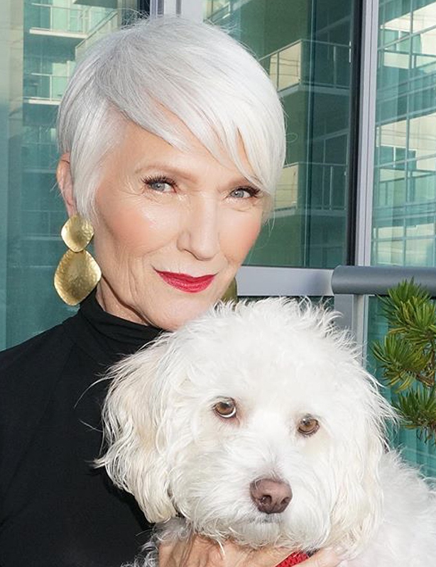 Author Maye Musk with her dog