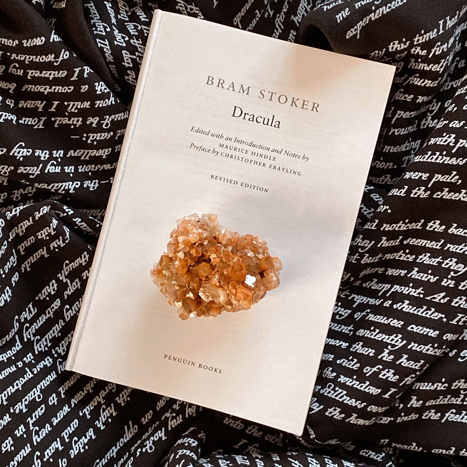 The first page of Dracula by Bram Stoker with an amber crystal cluster on it