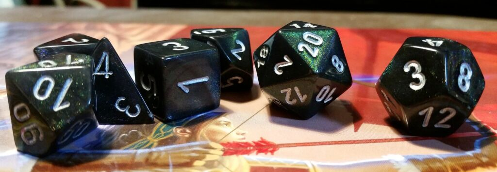 A set of 7 polyhedral dice on the picture of an archer, bow drawn.