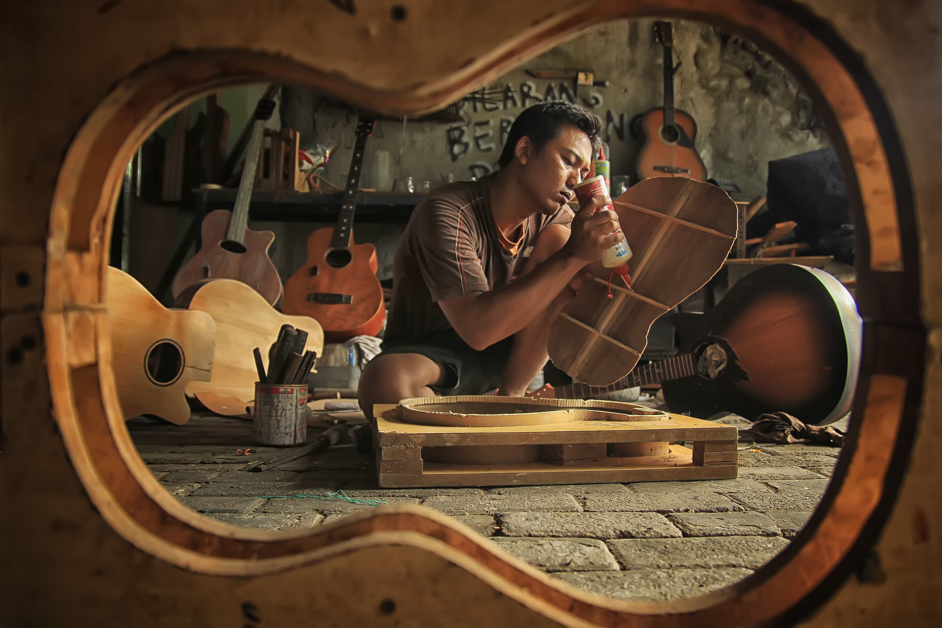 A man working on a hand-made guitar