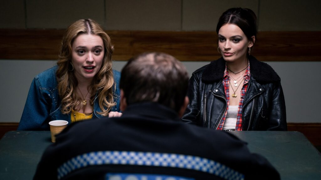 Amy and Maeve talking to police on Netflix Sex Education