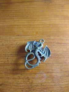 cross stitch needle minder shaped like a dragon