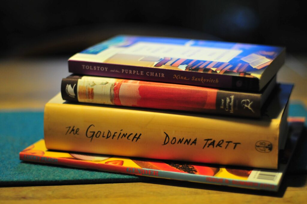 A stack of four books to read during a pandemic