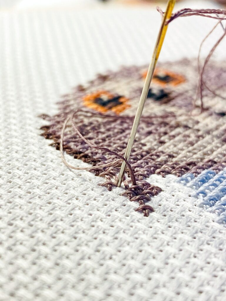 cross stitched owl on fabric