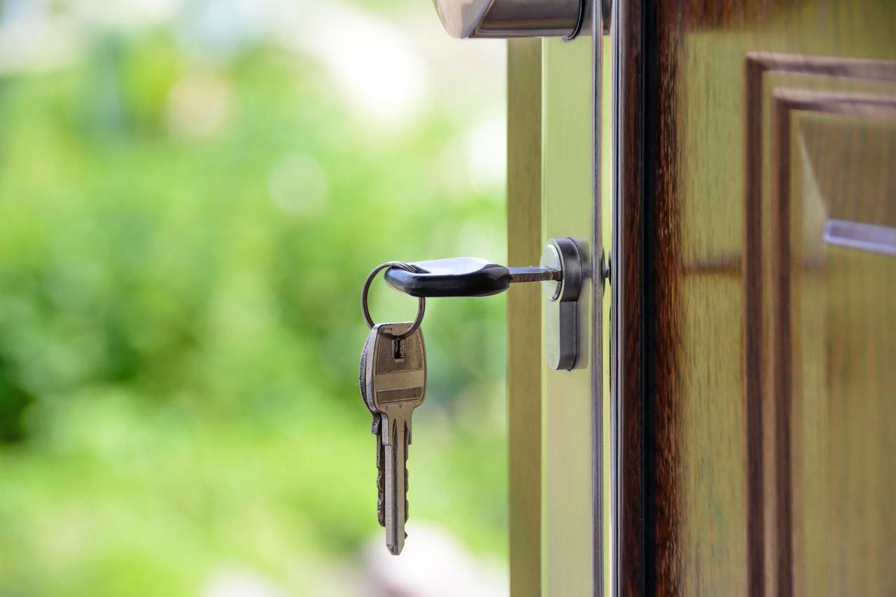 Key in the door of new rental