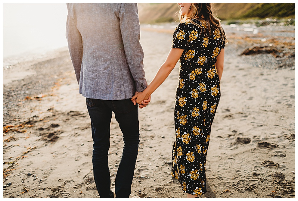couple walking holding hands on beach