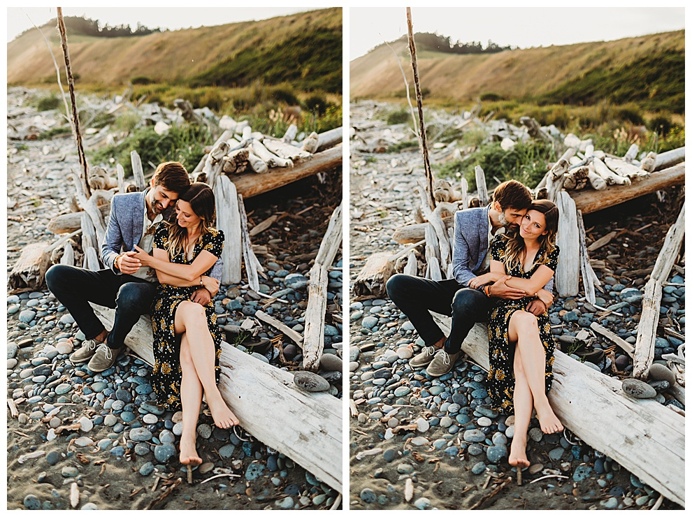 couple snuggles on beach at Whidbey Island