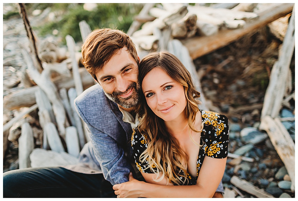 couple hug and smile at camera