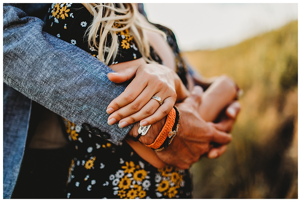 couple hugging back to front holding hands