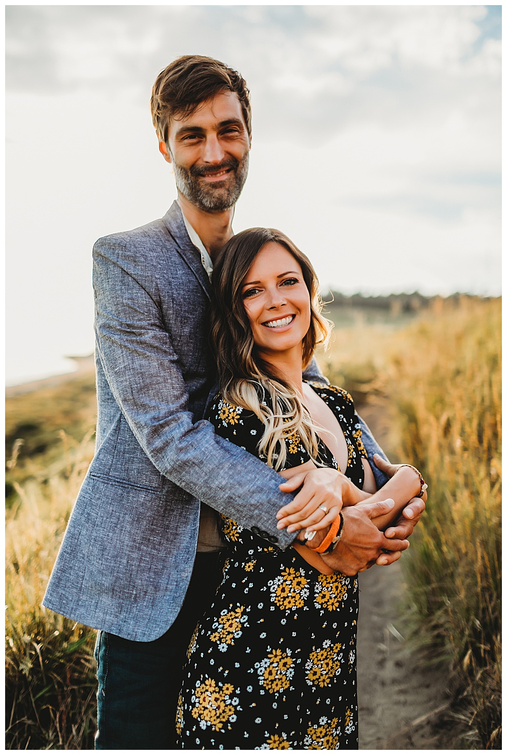 man wraps arms around woman
