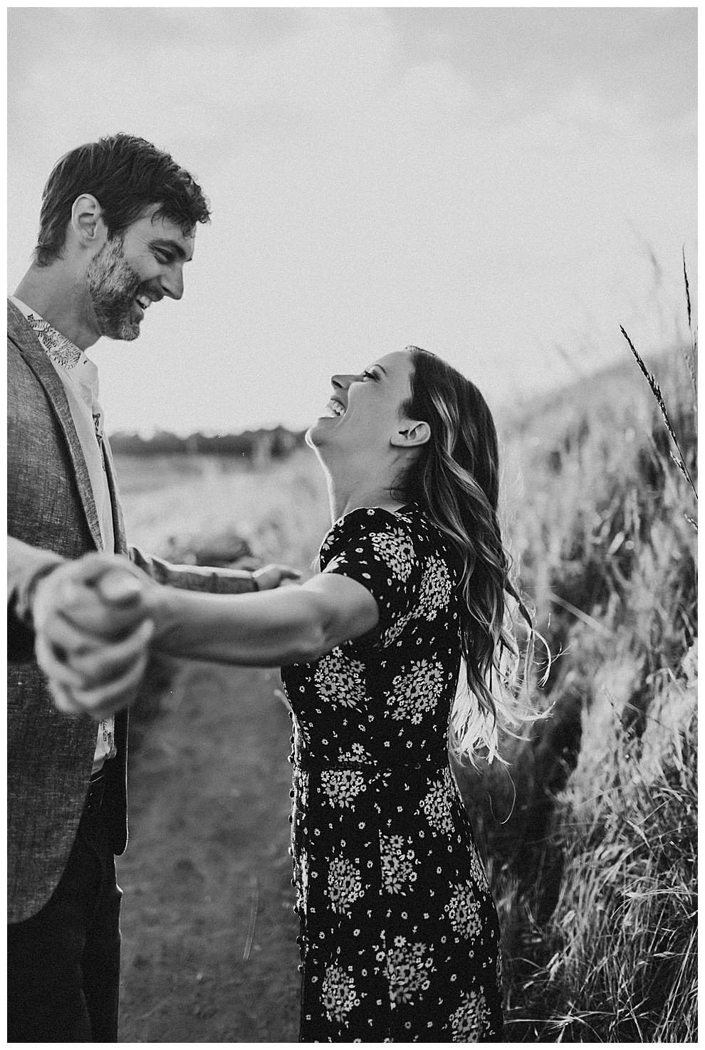 couple laughing during outdoor engagement adventure photos
