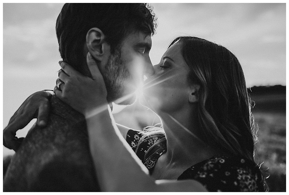 couple kiss at sunset