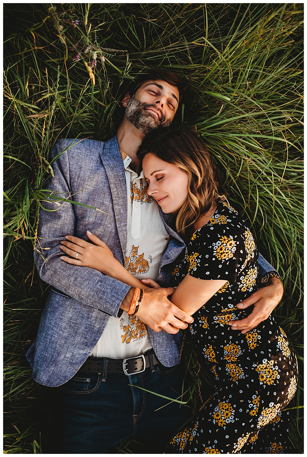 man and woman lying in tall green grass together