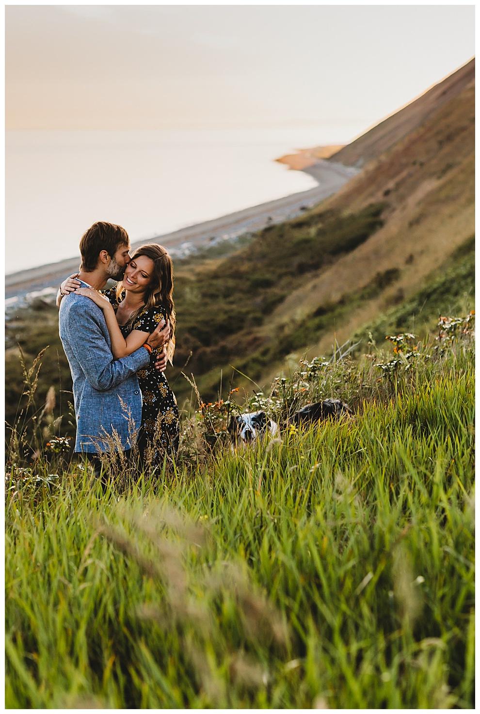 good looking young couple hugging on island coast