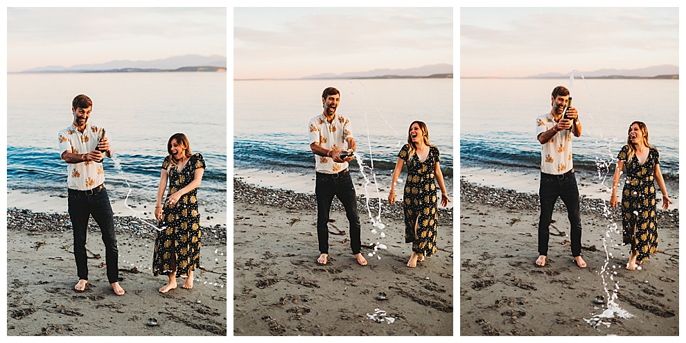 couple popping bottle of champagne on beach