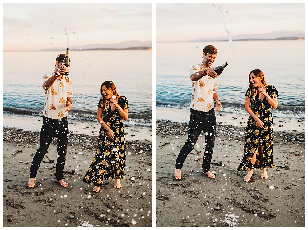 couple popping champagne during engagement shoot