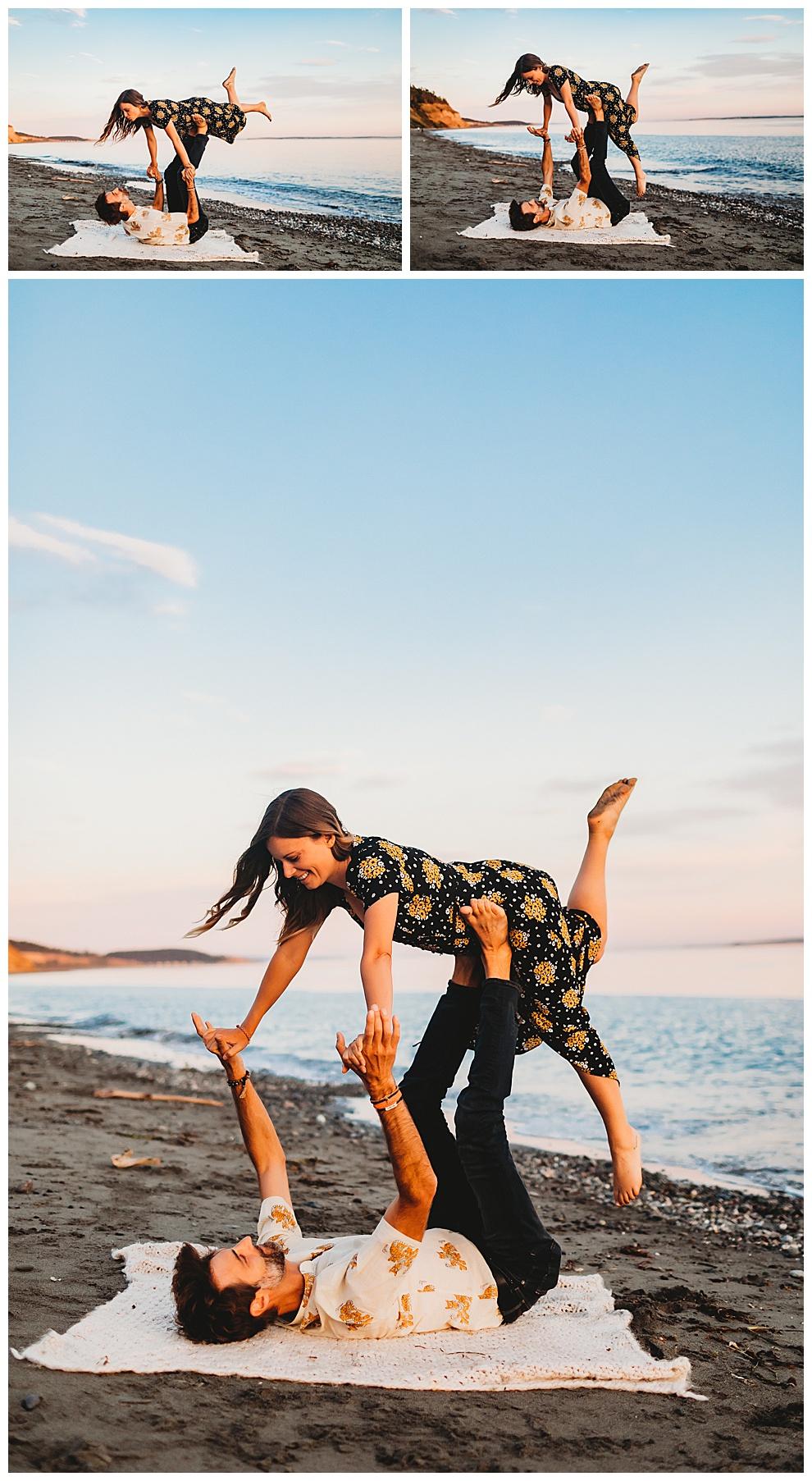 couple doing playful yoga pose on beach
