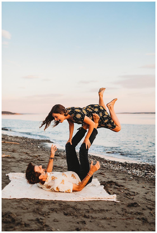 man and woman goofing around on beach