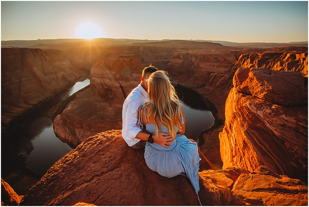 couple by a cliff at sunset