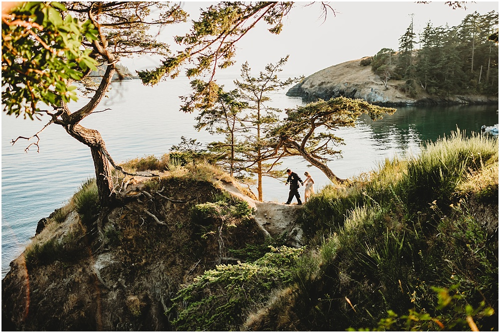 Bride and groom explore nature