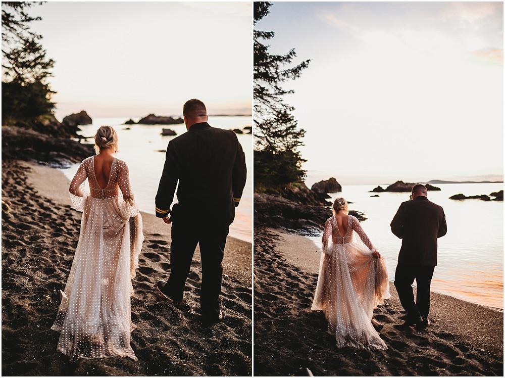 Bride and groom walk on the beach at dusk