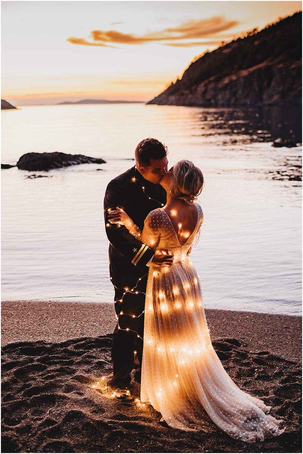 Bride and groom illuminated by lights