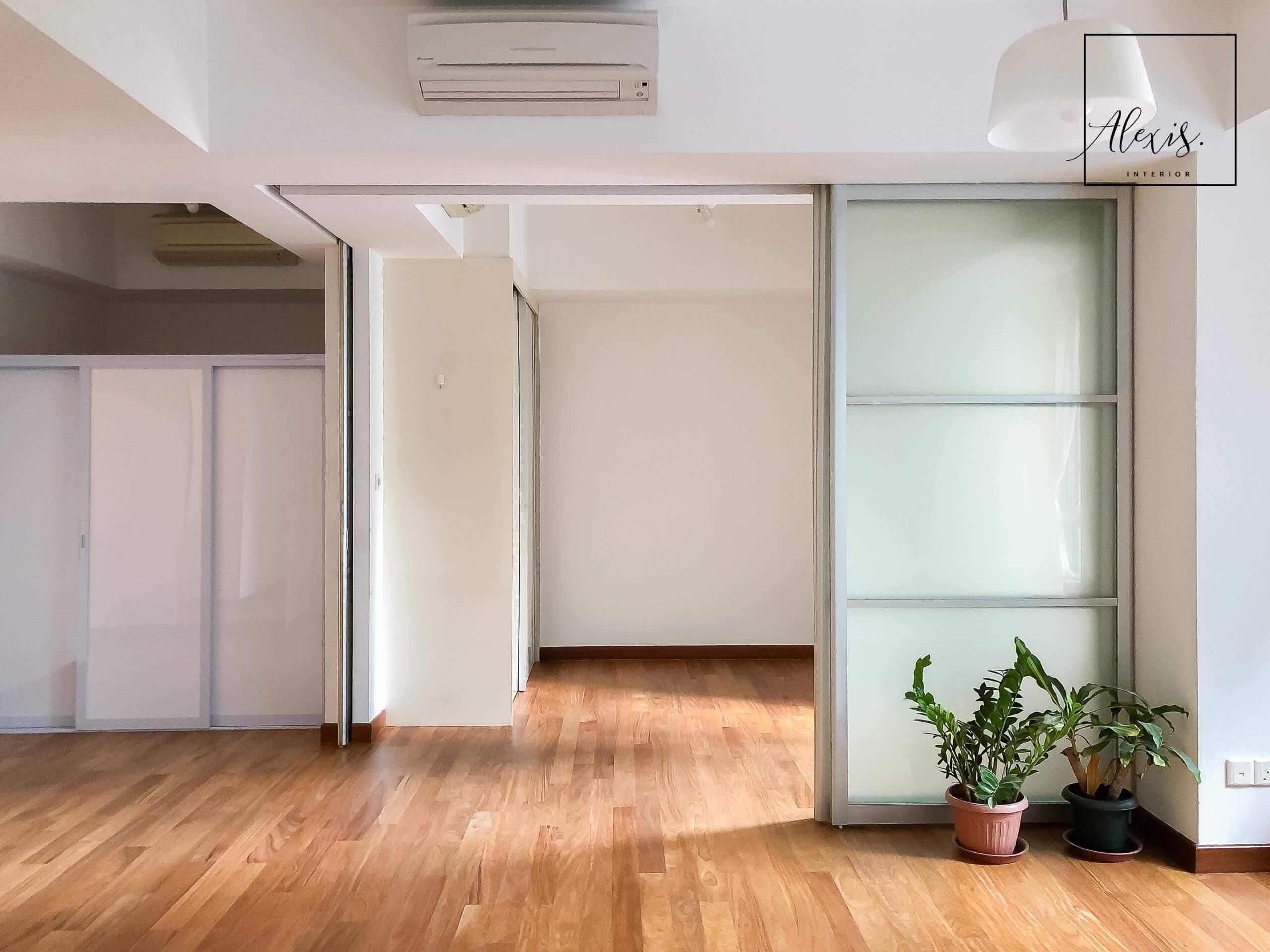 The Sail @ Marina Bay Scandinavian living area with plants and sliding doors.