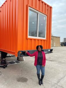 CFO Angelina Strickland with a cottage in production
