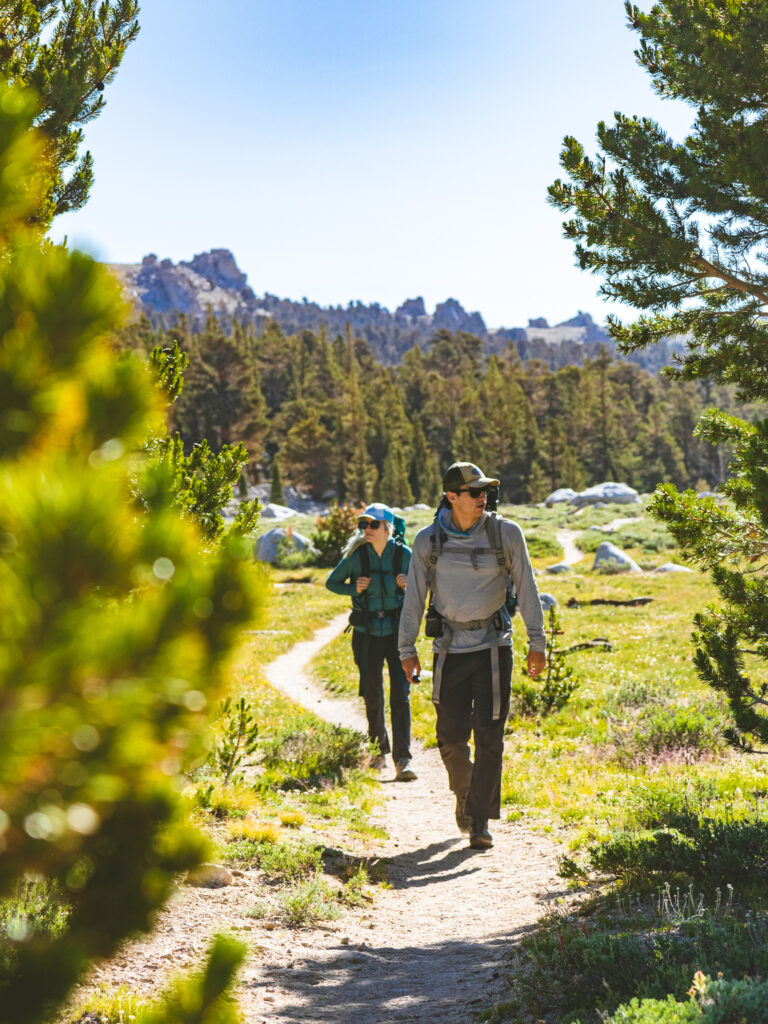 Adventure Couple wearing the Best Hiking Shoes for Backpacking Adventures
