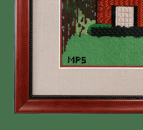 detail of home needlepoint in wooden fram
