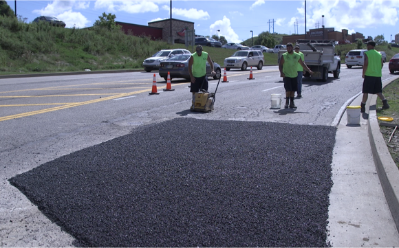 Laying Asphalt on University Town Center Drive.