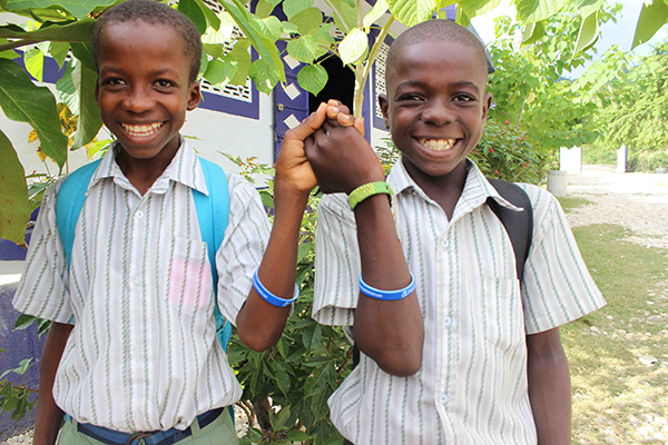 Smiling Students Wearing Wristbands