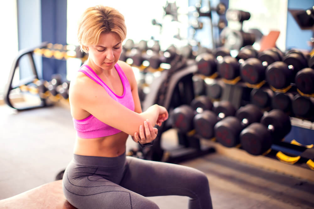 Three issues can cause elbow pain when you're lifting weights