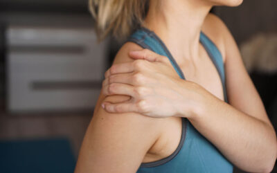What is causing the pain on top of my shoulder bone?