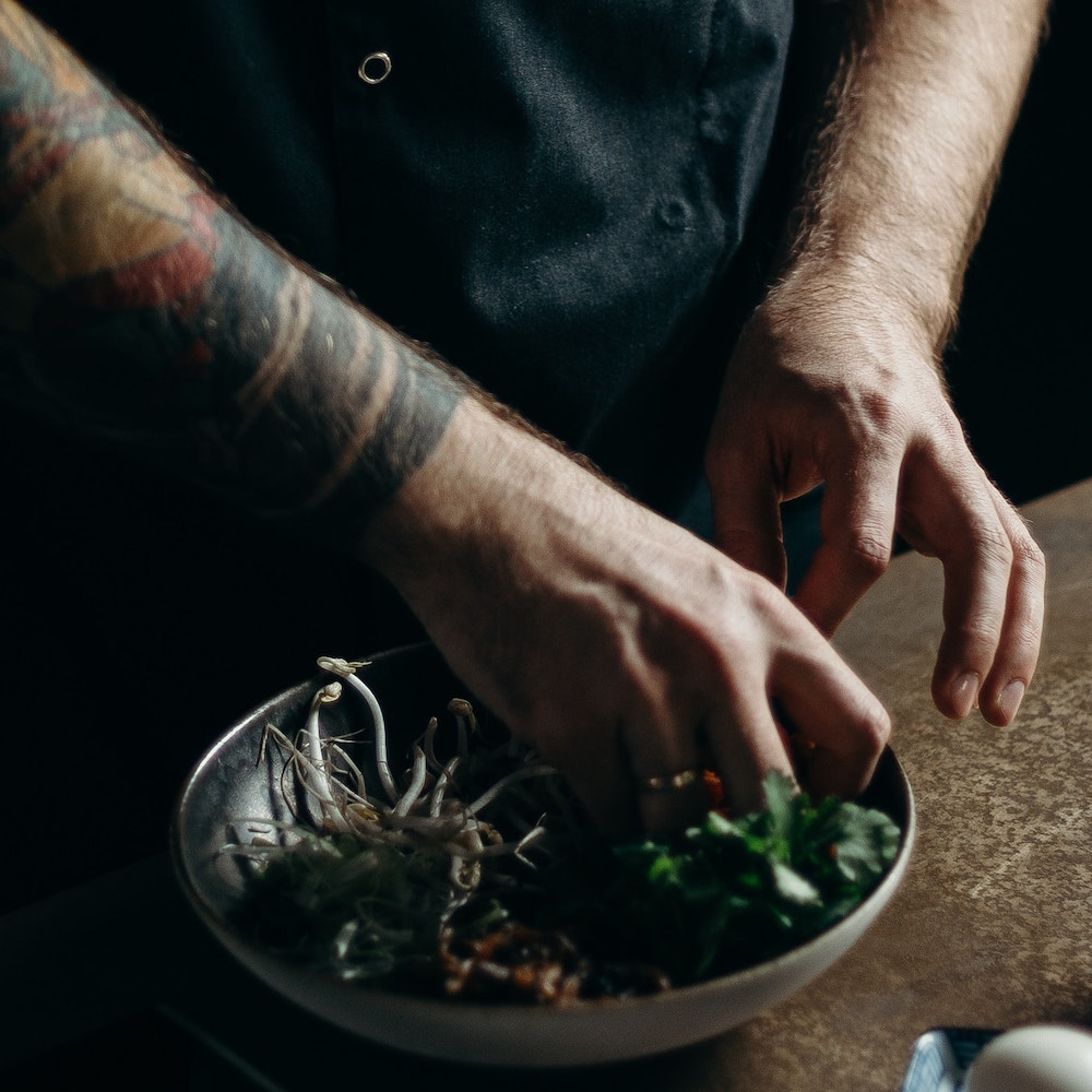 a-chef-preparing-a-dish-3338539