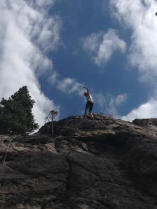 Emily rock climbing.