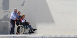 woman in wheelchair being pushed