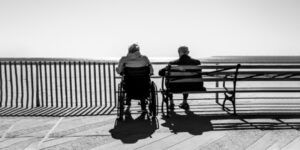 elderly man and woman sitting together