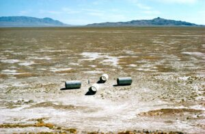 Four large cement cilinders in the desert