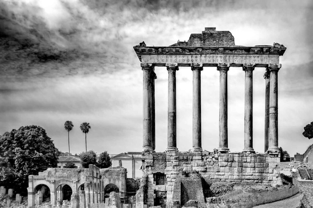 The Temple of Saturn was an ancient Roman temple to the god Saturn. Its ruins stand at the foot of the Capitoline Hill at the western end of the Roman Forum. The original dedication of the temple is traditionally dated to 497 BC.