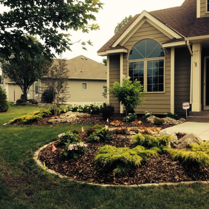 Beautifully landscaped front yard of a home in Hastings, Minnesota