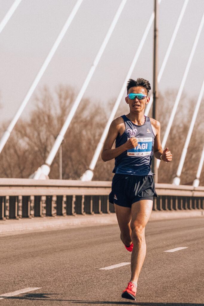 athlete running on bridge