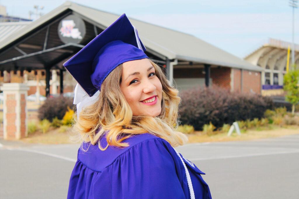 proud, female college graduate