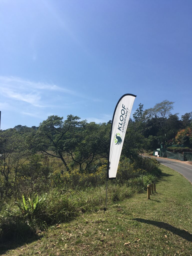 Kloof Conservancy banners in the middle of a protected grassland