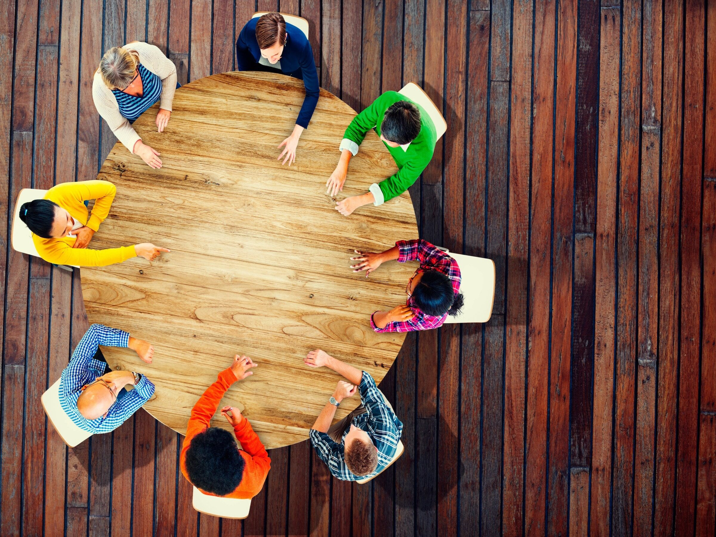 Team collaboration around a circular desk